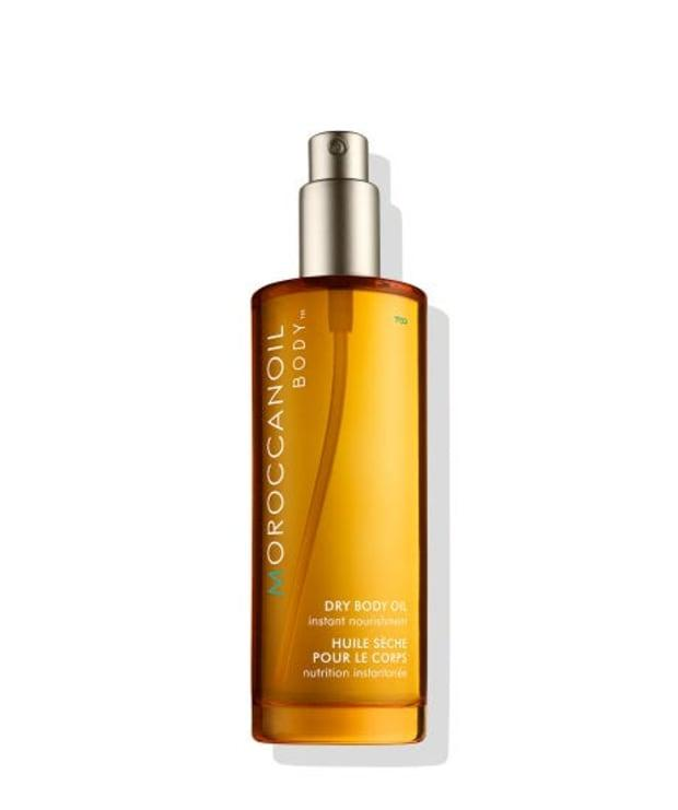 """<p><strong>Moroccanoil Dry Body Oil, $48, <a href=""""https://shop-links.co/1707433992363659425"""" rel=""""nofollow noopener"""" target=""""_blank"""" data-ylk=""""slk:available here"""" class=""""link rapid-noclick-resp"""">available here</a>: </strong>""""It was the scent of this oil that first drew me in — musky and sweet, with a hint of orange blossom — but the fast-absorbing, non-greasy formula and easy-to-use mist-on applicator solidified my obsession."""" —Stephanie Saltzman, Beauty Director</p>"""