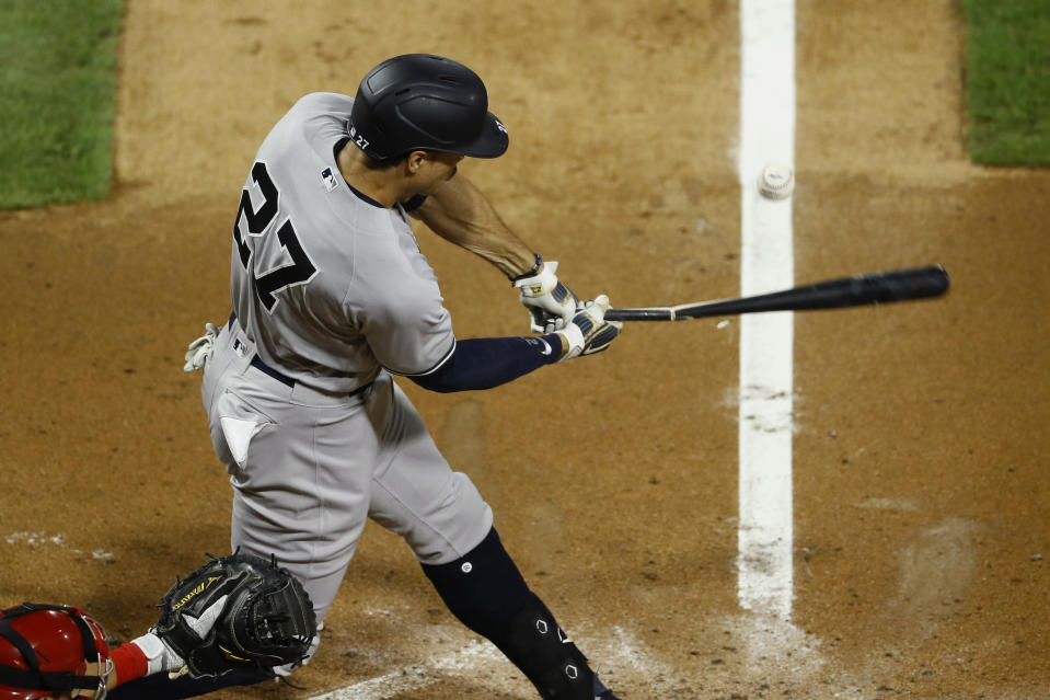 New York Yankees' Giancarlo Stanton breaks his bat on a pop out against Philadelphia Phillies starting pitcher Aaron Nola during the fourth inning of the second baseball game in a doubleheader, Wednesday, Aug. 5, 2020, in Philadelphia. (AP Photo/Matt Slocum)