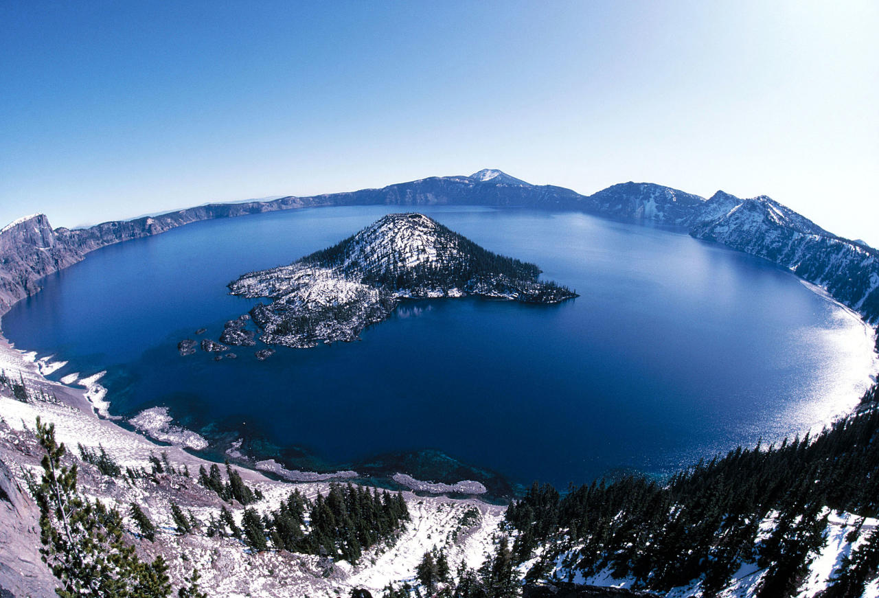 MANDATORY BYLINE - PIC BY FRANCOIS GOHIER / ARDEA / CATERS NEWS - (Pictured Giant crater lake - The crater lake at Crater Lake National Park in Oregon was formed about 150 years ago by the collapse of the volcano Mount Mazama.) - From the vivid colours of a beautiful hot spring to a random rock formation that looks just like an elephant - these are the extraordinary phenomenons of the natural world. The outlandish landscapes might look like something from another planet but they are in fact completely natural eccentricities. And while these mind-blowing quirks of Mother Nature might continue to puzzle scientists, they also continue to draw in tourists fascinated by the surreal spectacles. SEE CATERS COPY.