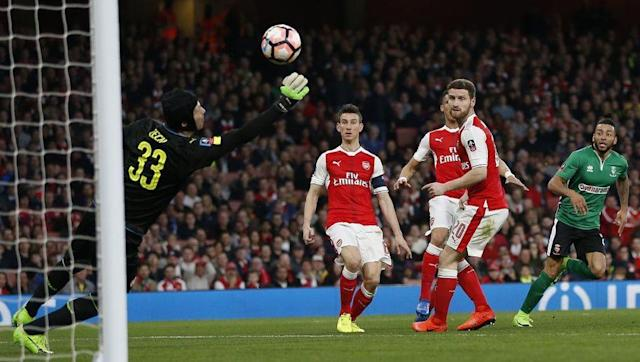 <p>Petr Cech hasn't had the best of seasons between the sticks for Arsenal, but in a combined XI, he's probably still the better option out of David Ospina, Willy Caballero and Claudio Bravo.</p> <br><p>Caballero has filled in quite well for the dropped Bravo over at the Etihad, but you do always get the feeling that he is a mistake waiting to happen - just a slightly weaker feeling than you get with Bravo.</p> <p>On paper, Cech is arguably still the most solid out of the four to choose from.</p>