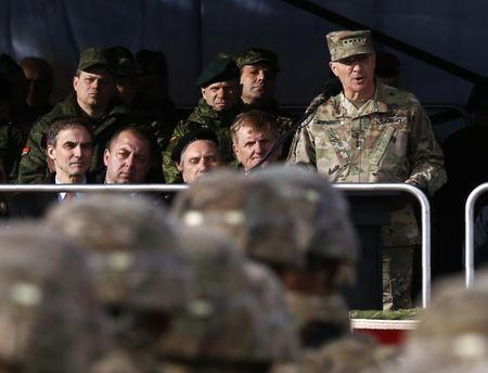 Commander of U.S. Forces in Europe, General Scaparrotti speaks during U.S.-led NATO troops welcoming ceremony at polygon near Orzysz