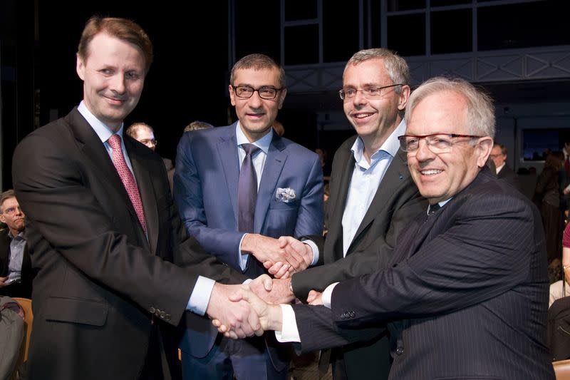 Nokia's chairman Risto Siilasmaa, Nokia's President and Chief Executive Rajeev Suri, Telecom equipment maker Alcatel-Lucent's Chief Executive Officer Michel Combes and Alcatel-Lucent's chairman of the supervisory board Philippe Camus pose in Paris