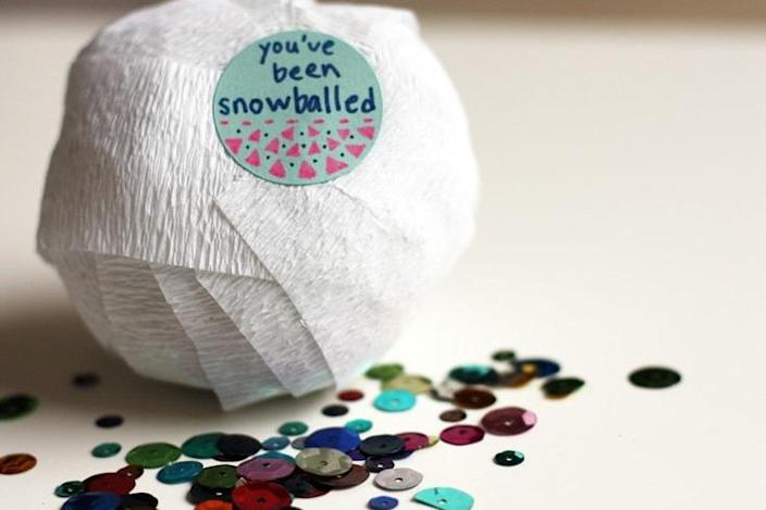 """<p>This clever interactive gift-wrapping idea from <a href=""""http://speckled-egg.blogspot.com/2010/12/surprise-snowballs.html"""" rel=""""nofollow noopener"""" target=""""_blank"""" data-ylk=""""slk:Speckled Egg"""" class=""""link rapid-noclick-resp"""">Speckled Egg</a> is a great way to make gifting money just a little more fun. Start wrapping white crepe paper into a ball and insert coins, bills, and other small surprises like candy or knickknacks along the way. This snowball is sure to delight and surprise. <i>(Photo: <a href=""""https://www.etsy.com/listing/84796107/snowball-surprise-ball-party-favor"""" rel=""""nofollow noopener"""" target=""""_blank"""" data-ylk=""""slk:Etsy"""" class=""""link rapid-noclick-resp"""">Etsy</a>)</i></p>"""