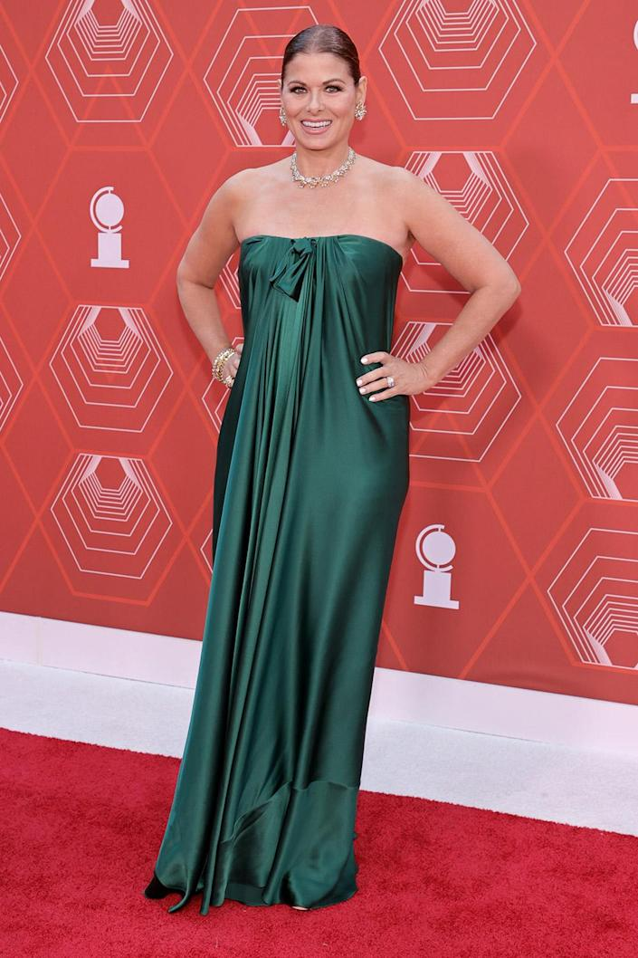 <p>Debra Messing, who is presenting at the awards, made us all green with envy with her red carpet look. </p>