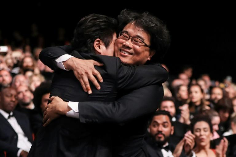 Bong Joon-Ho celebrates becoming the first Korean director to win the Palme d'Or