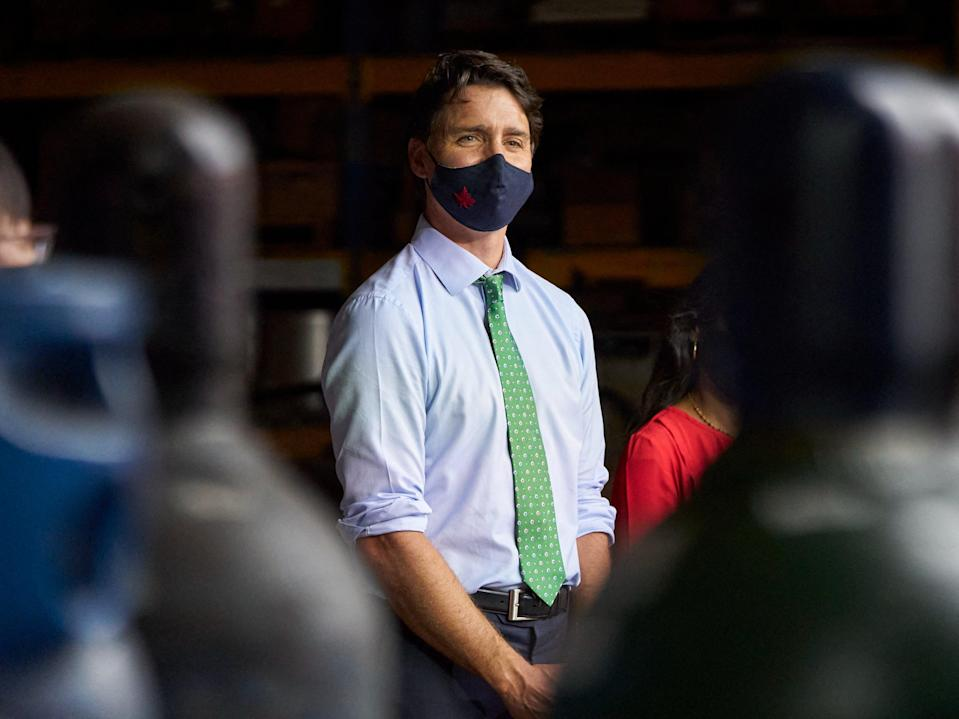 Trudeau listens to protestors during a campaign event in Cambridge, Ontario, on Sunday (AFP via Getty Images)