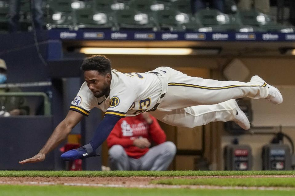 Milwaukee Brewers' Pablo Reyes scores during the eighth inning of a baseball game against the St. Louis Cardinals Wednesday, May 12, 2021, in Milwaukee. Reyes scored from first on a double by Travis Shaw. (AP Photo/Morry Gash)