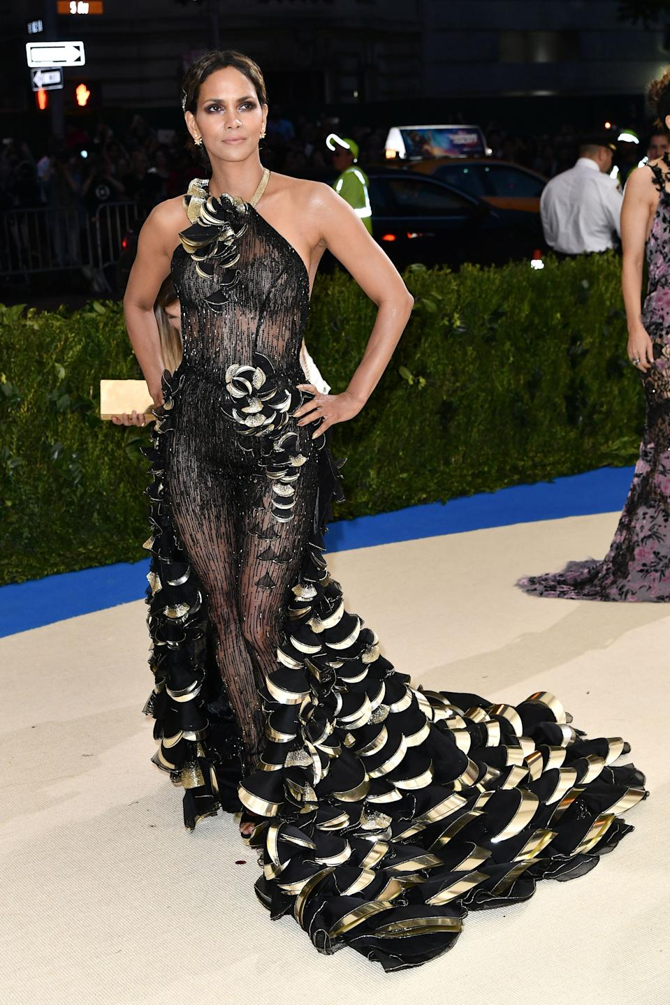 """<h1 class=""""title"""">Halle Berry in Versace and Atelier Swarovski earrings</h1><cite class=""""credit"""">Photo: Shutterstock</cite>"""