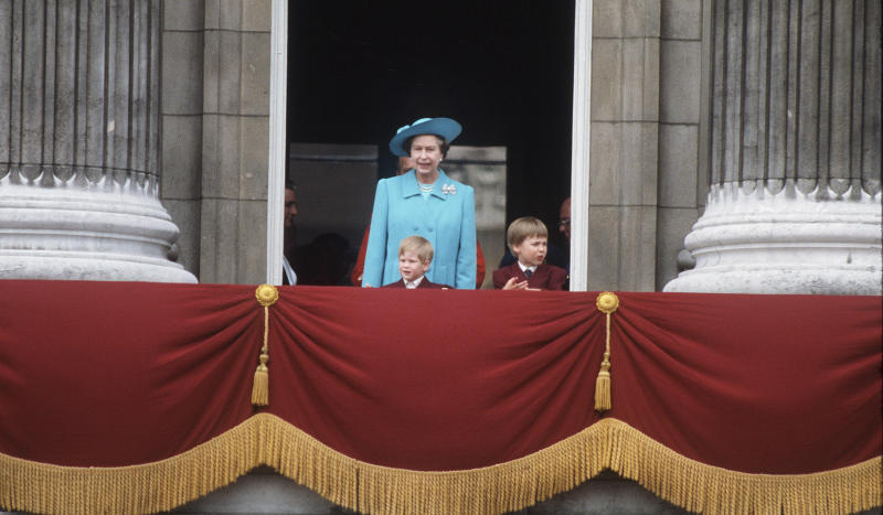 Queen Elizabeth II with the young Prince William and Prince Harry on the balcony of Buckingham Palace after the annual Trooping of the Colour ceremony in June, 1988.