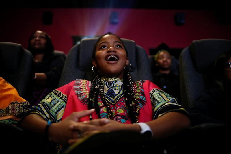 "Ron Clark Academy sixth-grader De Ja Little, 12, joins classmates in watching the film ""Black Panther"" on Feb. 21, 2018."