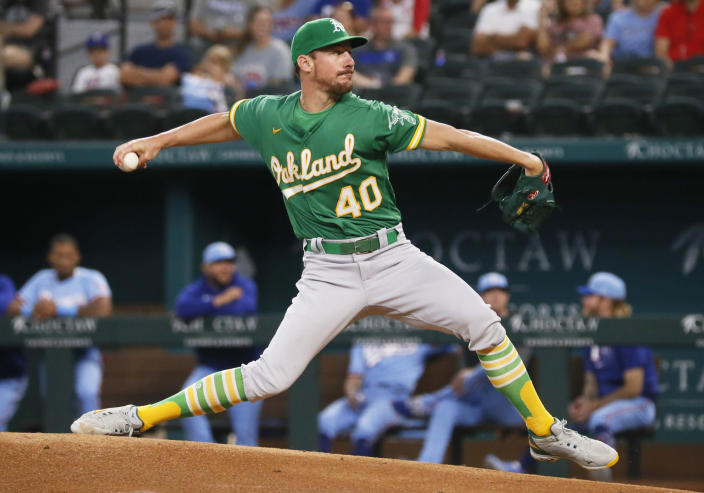 Oakland Athletics starting pitcher Chris Bassitt throws against the Texas Rangers during the first inning of a baseball game in Arlington, Texas, Sunday, July 11, 2021. (AP Photo/Ray Carlin)