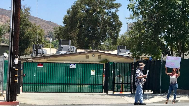 At a migrant detention facility for children in California, a protest of two