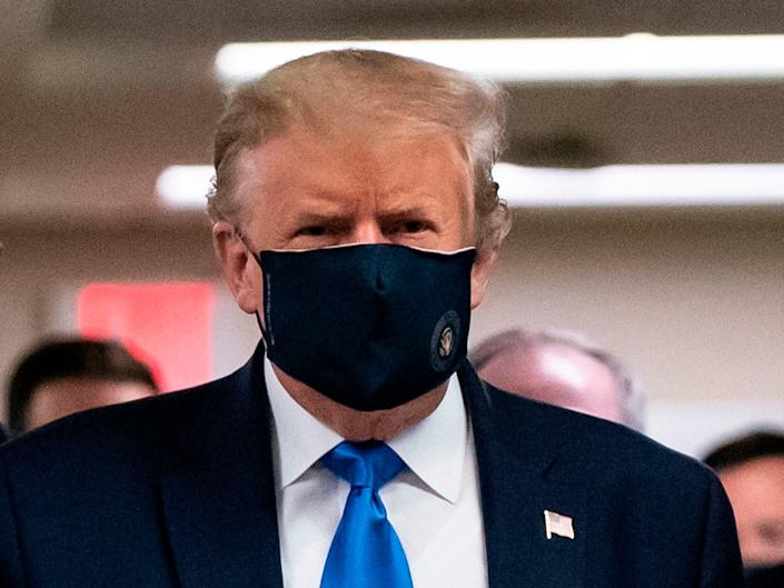 President Donald Trump wearing a face mask in public for the first time during a visit to the Walter Reed National Military Medical Center in Bethesda, Maryland, on July 11, 2020.