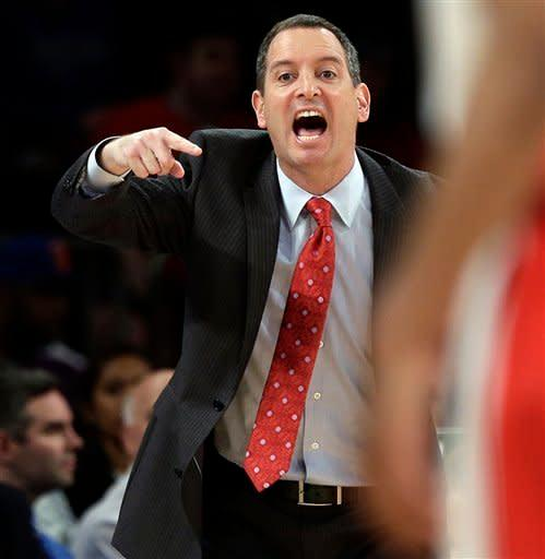Rutgers head coach Mike Rice calls out to his team during the first half of an NCAA college basketball game against DePaul at the Big East Conference tournament, Tuesday, March 12, 2013, in New York. (AP Photo/Frank Franklin II)