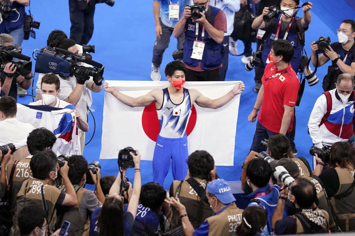 Daiki Hashimoto, of Japan, celebrates after winning the gold medal in the artistic gymnastics men's all-around final at the 2020 Summer Olympics, Wednesday, July 28, 2021, in Tokyo. (AP Photo/Gregory Bull)