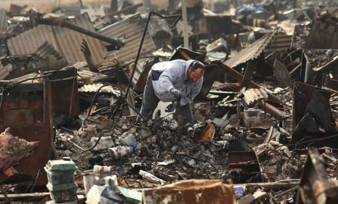 A man searches through the remains of his home on Dec. 4 in Breezy Point, Queens, N.Y., a neighborhood hit hard by Sandy.