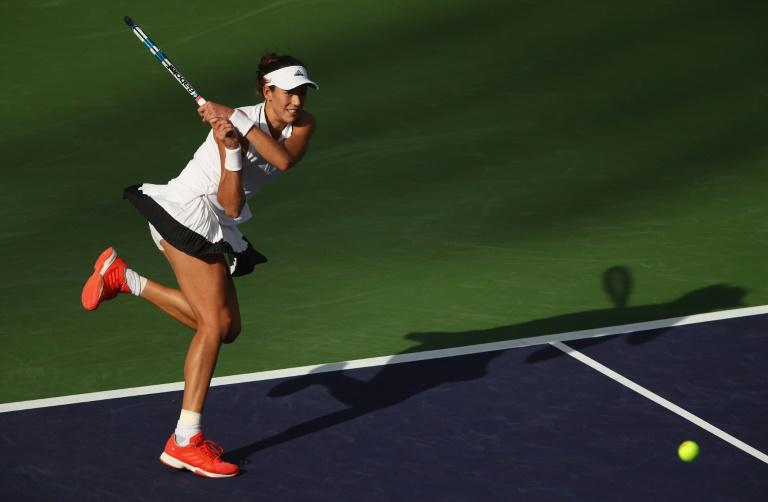 Garbine Muguruza (pictured) of Spain survived a fierce challenge from US teenager Kayla Day to reach the fourth round of the WTA Indian Wells hard court tournament in California, on March 12, 2017