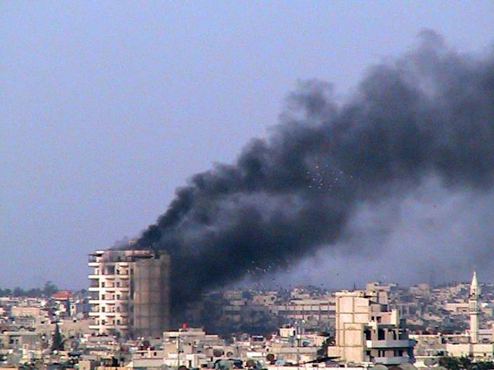 """In this March 9, 2012 citizen journalism image provided by the Homs City Union of The Syrian Revolution, smoke rise from a building that was shelled by the Syrian army, at Jeb al-Jandali neighborhood in Homs province, central Syria. Two prominent Syrian dissidents said Wednesday they have quit the main opposition group that emerged from the year-old uprising against the regime in Damascus in protest over what one of the men described as an """"autocratic"""" organization. (AP Photo/Homs City Union of The Syrian Revolution) THE ASSOCIATED PRESS IS UNABLE TO INDEPENDENTLY VERIFY THE AUTHENTICITY, CONTENT, LOCATION OR DATE OF THIS HANDOUT PHOTO"""