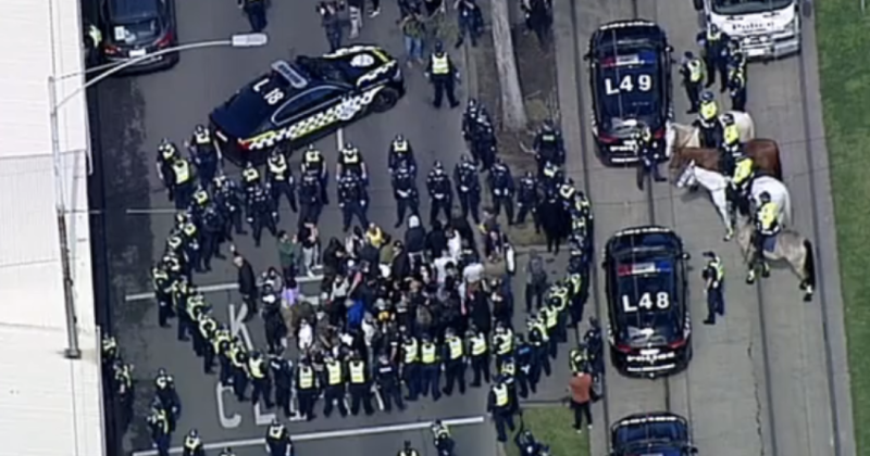 Picture of Victoria police surrounding protesters in Melbourne on Sunday