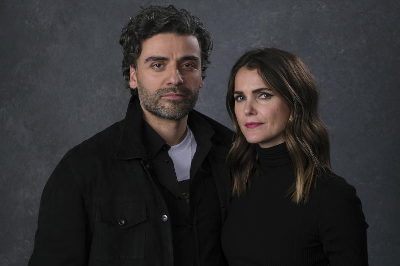 "This Dec. 3, 2019 photo shows Keri Russell, right, and Oscar Isaac posing for a portrait to promote their film ""Star Wars: The Rise of Skywalker"" in Pasadena, Calif. (AP Photo/Chris Pizzello)"