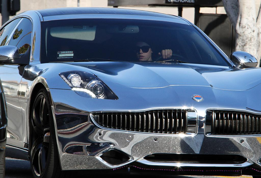 <strong>Justin Bieber<br />Fisker Karma<br />Approximate Base Price: $100,000<br /></strong>The Biebs made headlines last March when he received a $100,000 hybrid Fisker Karma for his 18th birthday from his manager Scooter Braun. The luxe sports car is completely covered in chrome and caught the attention of both police and media when the pop star was pulled over for driving more than 100 miles per hour on a Los Angeles freeway last summer, a speed he chalked up to being chased by paparazzi. He definitely hasn't learned a lesson, however. Just this week he got a brand new Ferrari delivered and reportedly to his house angered neighbors by speeding around his gated community of Calabasas, California late at night.