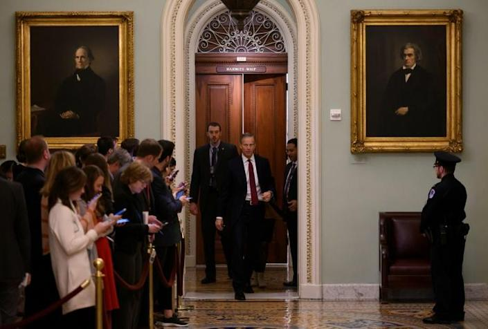 Reporters wait outside the US Senate chamber hearing only the third-ever impeachment trial of a US president (AFP Photo/ANDREW CABALLERO-REYNOLDS)