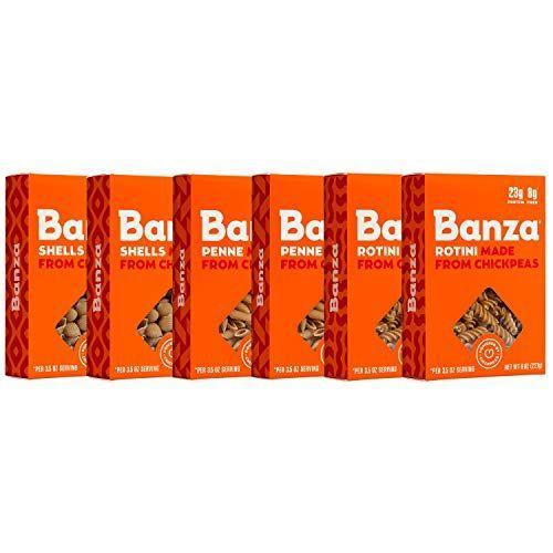 "<p><strong>BANZA</strong></p><p>amazon.com</p><p><strong>$25.00</strong></p><p><a href=""https://www.amazon.com/dp/B01IBIOMJ2?tag=syn-yahoo-20&ascsubtag=%5Bartid%7C2140.g.34284393%5Bsrc%7Cyahoo-us"" rel=""nofollow noopener"" target=""_blank"" data-ylk=""slk:Shop Now"" class=""link rapid-noclick-resp"">Shop Now</a></p><p>Crafted from chickpeas, Banza is pretty high in protein and low in carbs. It comes in a range of different shapes, including penne, rotini, and shells. One reviewer calls this pasta ""the real deal,"" adding, ""With a great taste and stacked nutrition facts, Banza pairs nicely with traditional pasta dish ingredients without sentencing me to the hours-long food coma that I had grown accustomed to from regular pasta.""</p><p><em><br></em></p><p><em>Per serving: 190 cal, 0 g fat, 32 g carbs, 45 mg sodium, 5 g fiber, 13 g protein</em></p>"