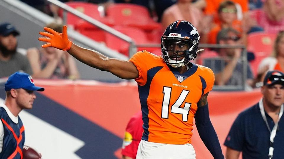 Courtland Sutton motions for a first down