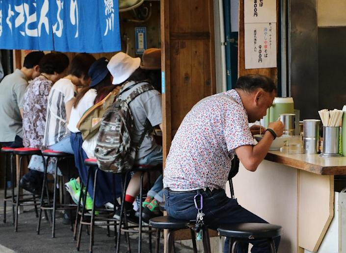Slurping it down: Japanese tradition dictates that gobbling down noodles is accompanied with a loud slurp (AFP Photo/YOSHIKAZU TSUNO)