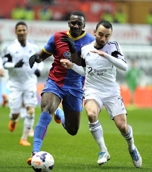 Swansea City' Leon Bitton (right) and Crystal Palace's Yannick Bolasie duel during theEnglish Premier League match at the Liberty Stadium, Swansea, Wales, Sunday March 2, 2014. (AP Photo/PA) UNITED KINGDOM OUT NO SALES NO ARCHIVE