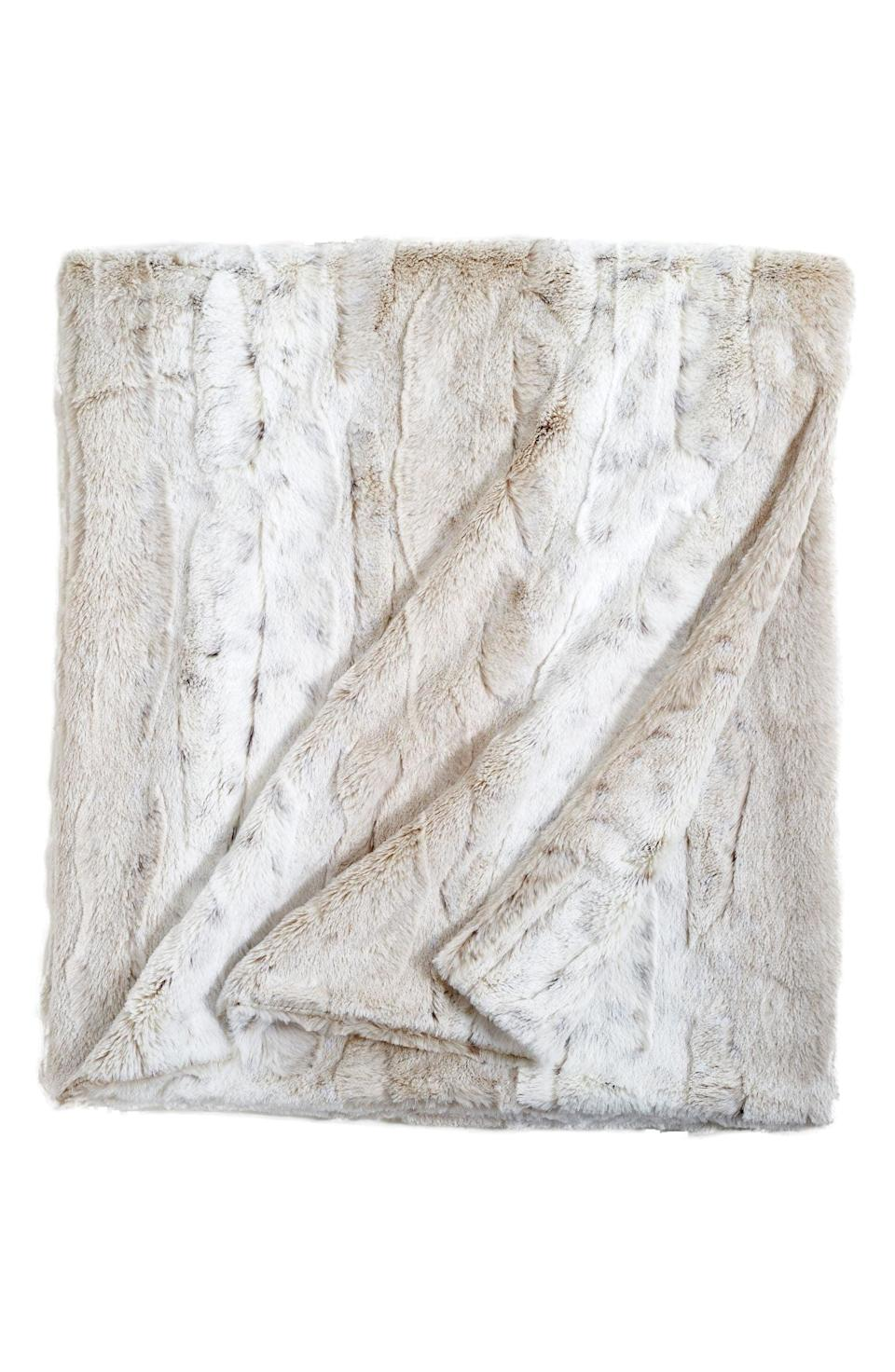 <p>Not only will the ultra-plush <span>Peri Home Faux Fur Throw Blanket</span> ($50) be their new best friend, it'll look stunning in their home. The faux fur is so soft, you might just keep this one for yourself. </p>