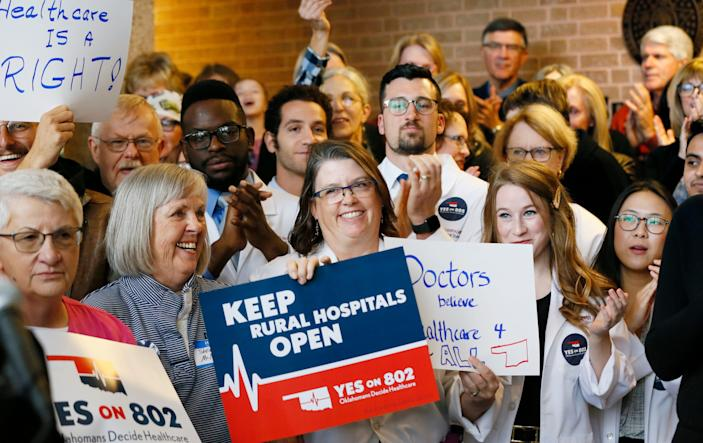 Supporters of Medicaid expansion cheer and applaud before they delivered petitions for State Question 802 to the Oklahoma Secretary of State's office in Oklahoma City, Thursday, Oct. 24, 2019.