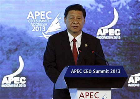 China's President Xi speaks at the APEC CEO Summit in Nusa Dua