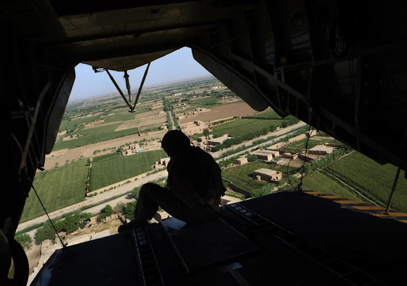 A US helicopter flies over the Marjah district in Helmand Province on May 3, 2011, where a mission killed one US service member and wounded two (AFP Photo/Bay Ismoyo)