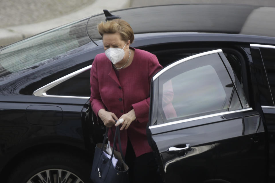 German Chancellor Angela Merkel arrives for a parliament session about a new law to battle the coronavirus pandemic at the parliament Bundestag in Berlin, Germany, Friday, April 16, 2021. (AP Photo/Markus Schreiber)