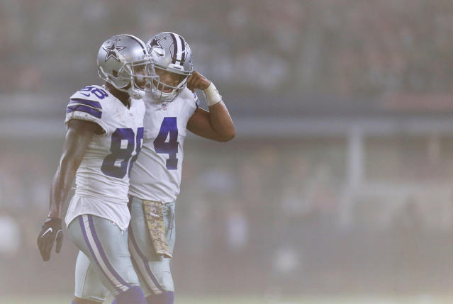 Dak Prescott (R) and Dez Bryant haven't been able to become a dynamic offensive duo this season. (AP)