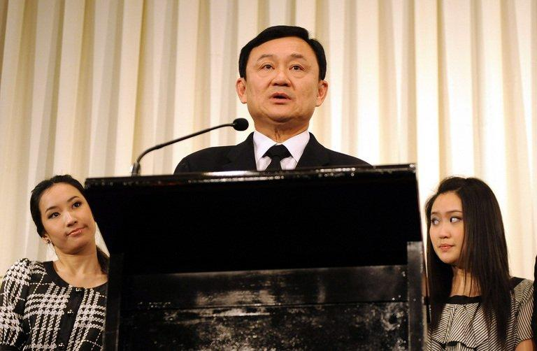 The flight attendant reportedly said she wanted to pour coffee over Paetongtarn Shinawatra (R)