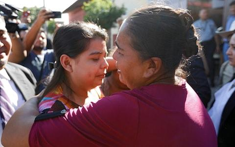 Miss Cortez is embraced by her mother after her acquittal in what is seen as a landmark case in El Salvador, home to some of the world's strictest anti-abortion laws - Credit: Jose Cabezas/Reuters