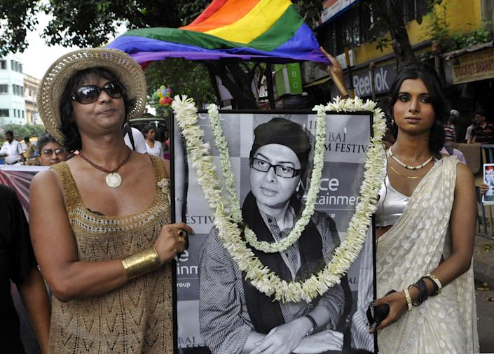 KOLKATA, INDIA - JULY 6: LGBT (Lesbian, Gay, Bisexual, and Transgender) members with the portrait of Bengali filmmaker late Rituparno Ghosh participate in a rally for their fundamental rights at Hazra on July 6, 2013 in South Kolkata, India. (Photo by Subhendu Ghosh/Hindustan Times via Getty Images)