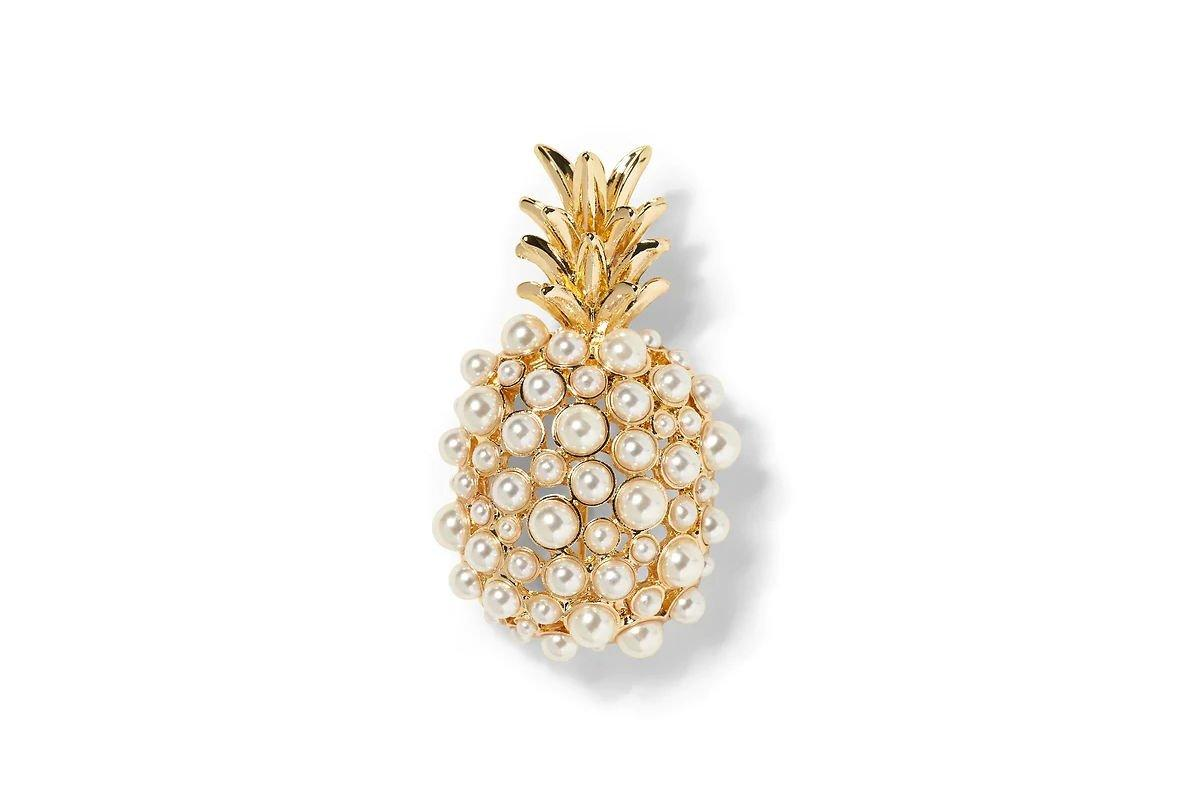 "<p>Pearl Pineapple Brooch</p> <p>BUY IT: $48, <a href=""http://gap.igs4ds.net/c/249354/383276/5554?subId1=SL%2CRX_1910_Brooch_ClassicJewelry%2Crogersc%2C%2CIMA%2C649677%2C201910%2CI&u=https%3A%2F%2Fbananarepublic.gap.com%2Fbrowse%2Fproduct.do%3Fpid%3D479771002%26pcid%3D999%23pdp-page-content"" target=""_blank"">bananarepublic.com</a></p> <p>Brooches are for everyone. While we often think of them pinned to a prim matching sweater set, they're much more versatile and can dress up any outfit.</p>"