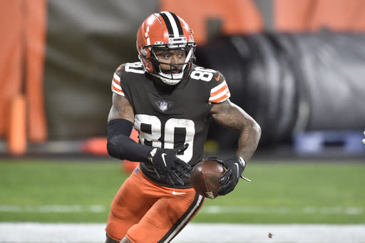 Cleveland Browns wide receiver Jarvis Landry (80) runs with the ball during an NFL football game against the Baltimore Ravens, Monday, Dec. 14, 2020, in Cleveland. After days of positive COVID-19 tests, disruptions and delays, the Browns found some normalcy and got to re-open their facility on Friday, Jan. 1, 2021, to resume getting ready to play the Pittsburgh Steelers and possibly end a postseason drought stretching back to 2002. (AP Photo/David Richard)