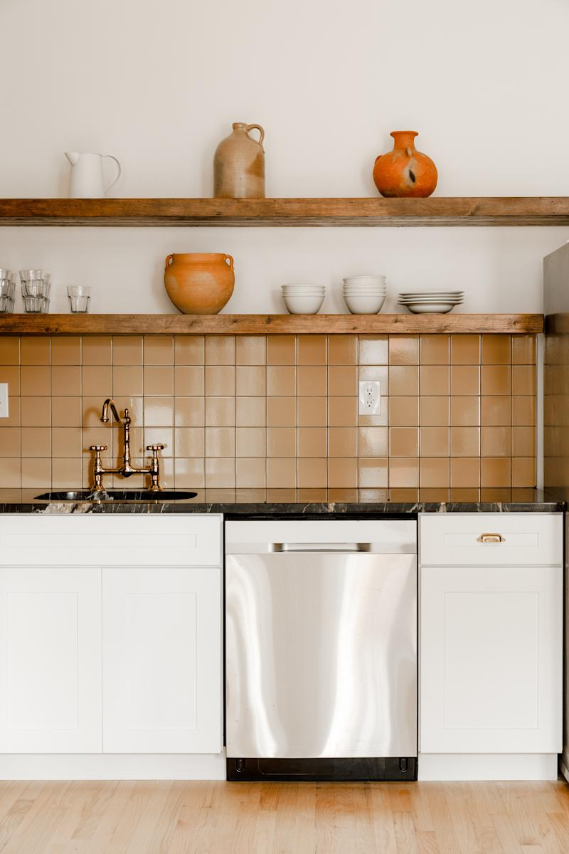 The communal kitchenette is designed to encourage guests to cook together and share a meal.