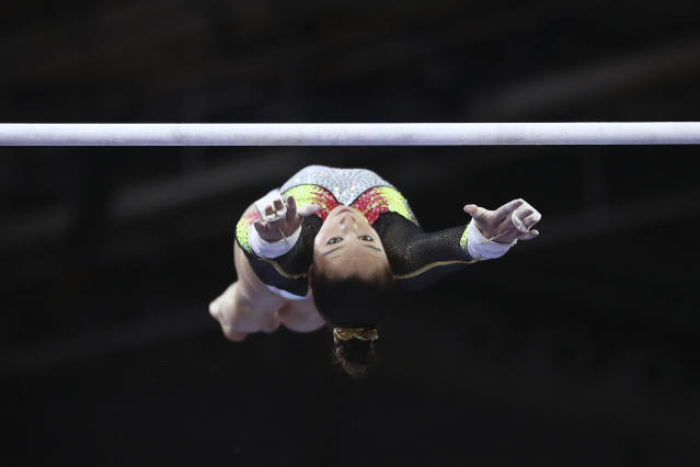 Nina Derwael of Belgium performs on the uneven bars to win a gold medal in the women's apparatus finals at the Gymnastics World Championships in Stuttgart, Germany, Saturday, Oct. 12, 2019. (AP Photo/Matthias Schrader)