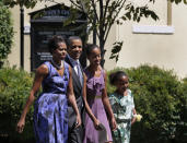 FILE - In this Sunday, July 17, 2011 file photo, President Barack Obama, second from right, walks with his family, first lady Michelle Obama, left, and their daughters Malia, third from left, and Sasha from St. John's Episcopal Church, to the White House in Washington. (AP Photo/Carolyn Kaster)