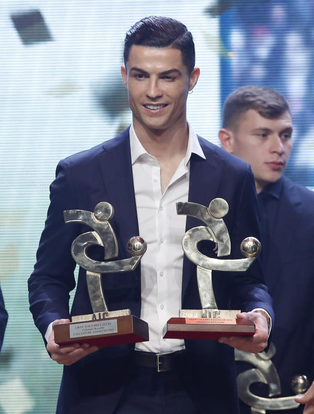 Juventus' Cristiano Ronaldo poses with the trophyes for best Italian Serie A player, during the Gran Gala' soccer awards ceremony, in Milan, Italy, Monday, Dec. 2, 2019. (AP Photo/Antonio Calanni)