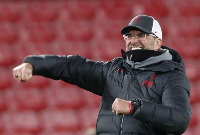 Liverpool manager Jurgen Klopp punches the air in celebration