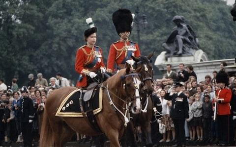 Queen Elizabeth II and Prince Philip return to Buckingham Palace in London after the Trooping The Colour ceremony in 1965 - Credit: Getty Images/Hulton Archive