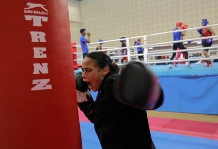 France's Amina Zidani trains with a punching bag during her practice session ahead of AIBA Women's World Boxing Championships at Indira Gandhi Indoor Stadium in New Delhi, India, November 12, 2018. REUTERS/Anushree Fadnavis