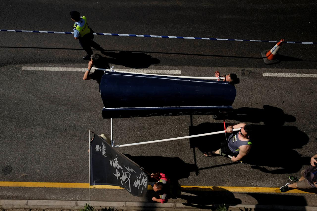 Protesters carry a mock coffin during a march ahead of June 4th anniversary of military crackdown on pro-democracy protesters in Tiananmen Square, in Hong Kong, China May 28, 2017. REUTERS/Bobby Yip