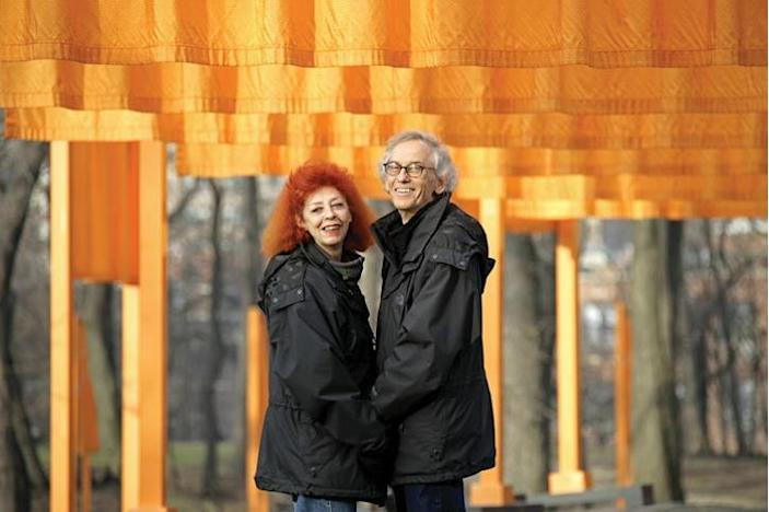 Christo stands in front of an installation with his artistic and romantic partner Jeanne-Claude.